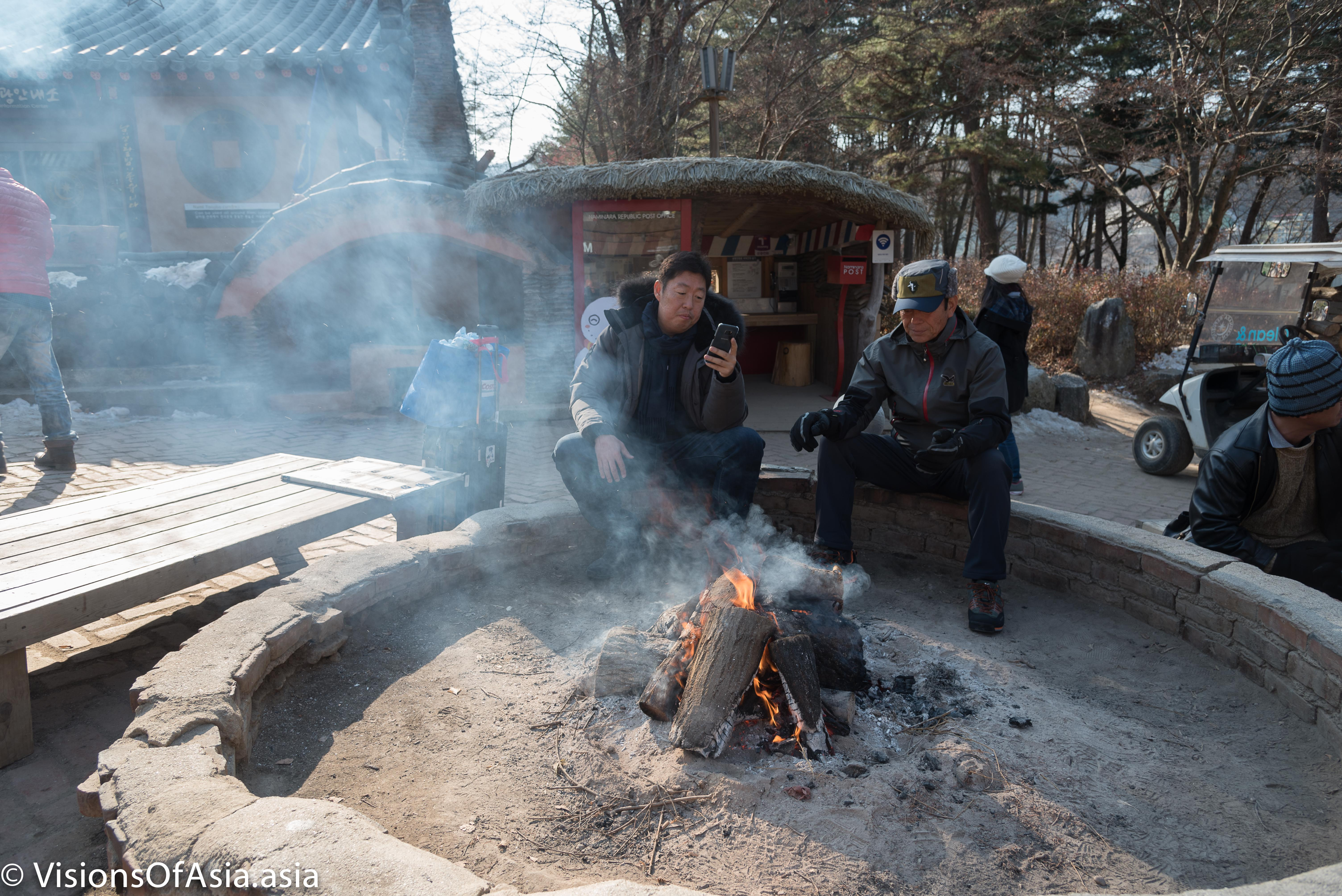 locals warming at fire Nami Island