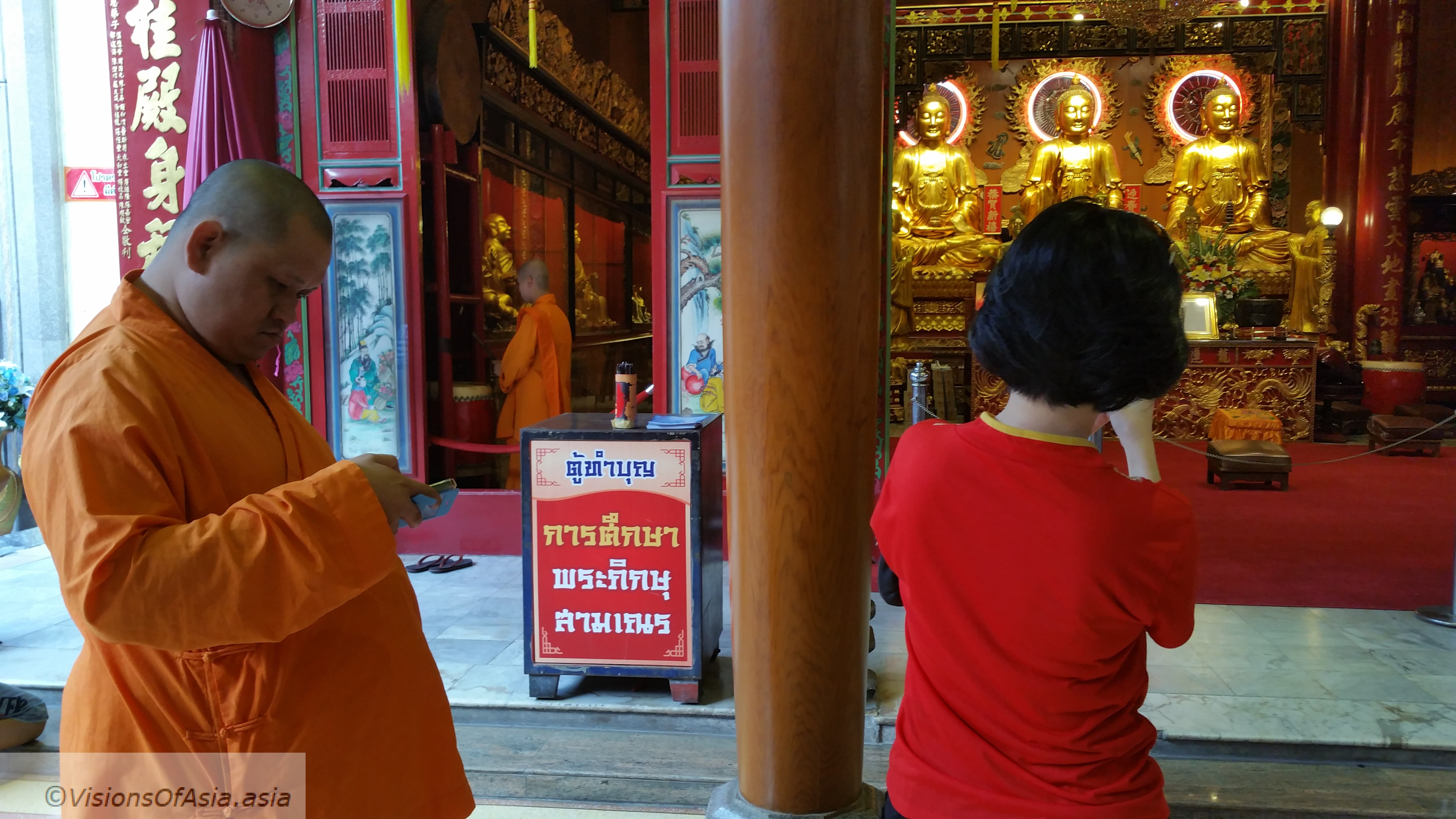 Monk and smartphone