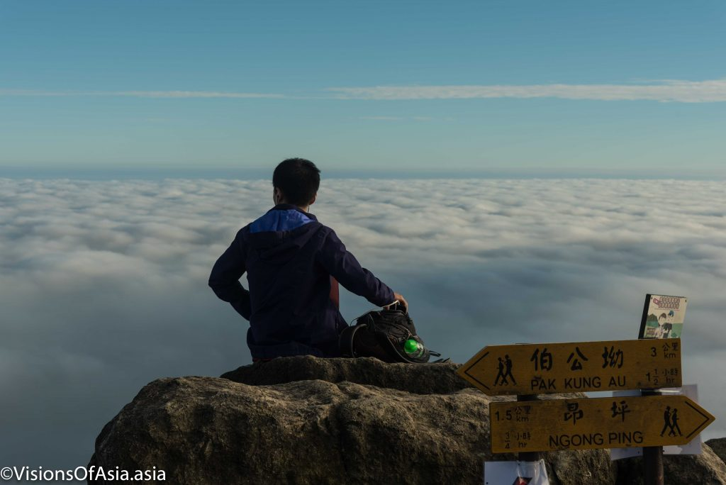 Hiker before sea of clouds
