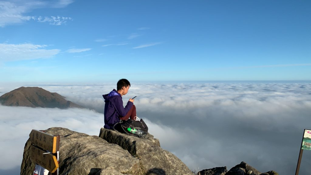 Hiker overlooking the sea of clouds