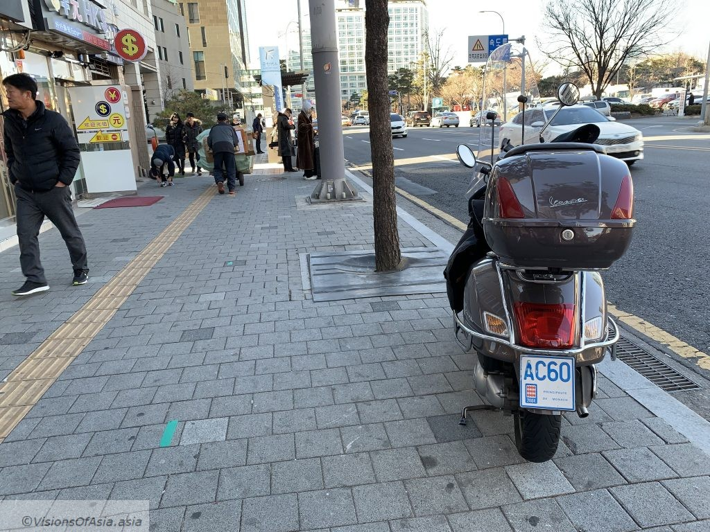 A surprising sight: a scooter with a Monaco plate in Seoul