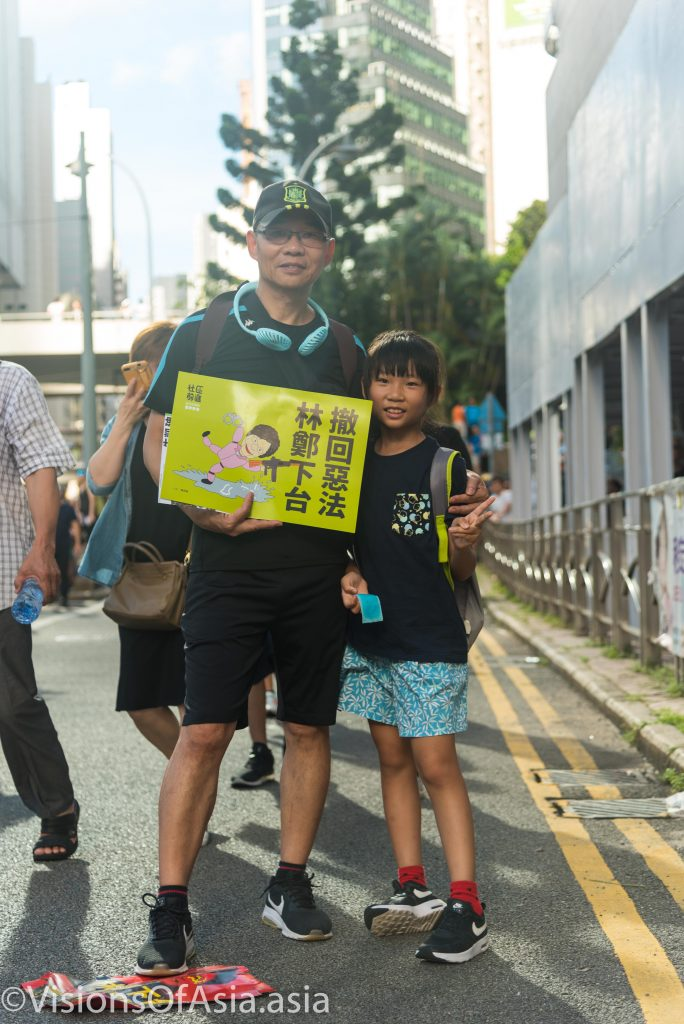 Father and daughter protest against extradition bill