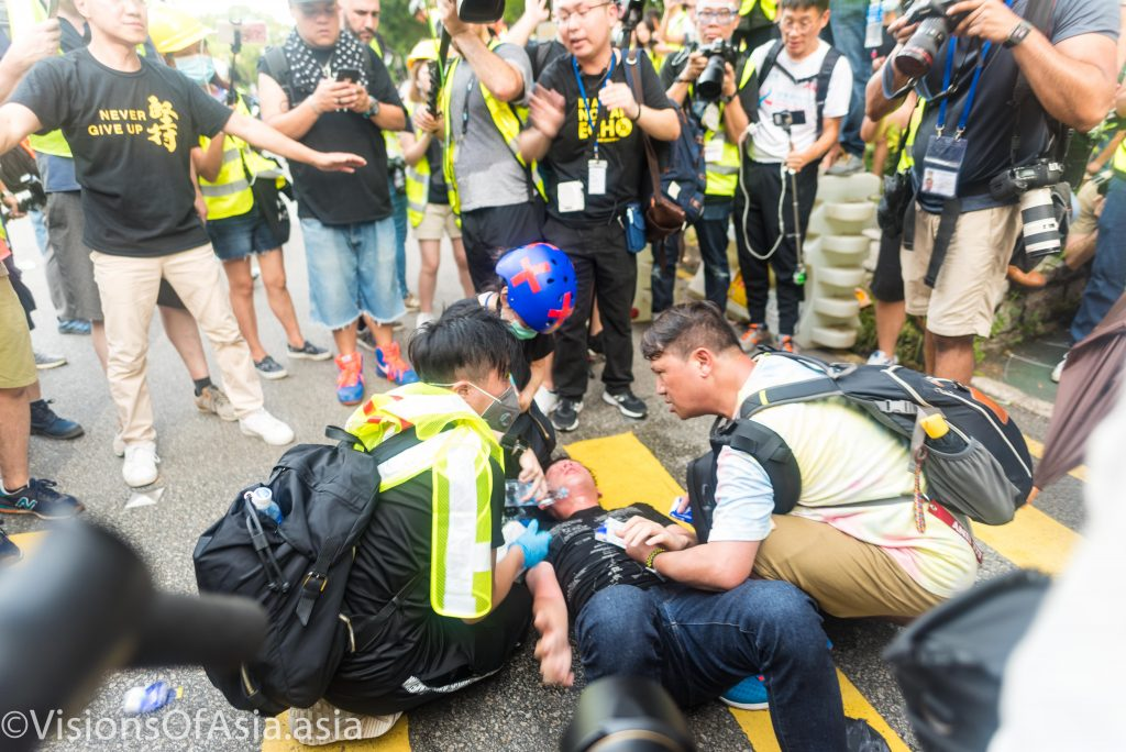 An injured protester is treated
