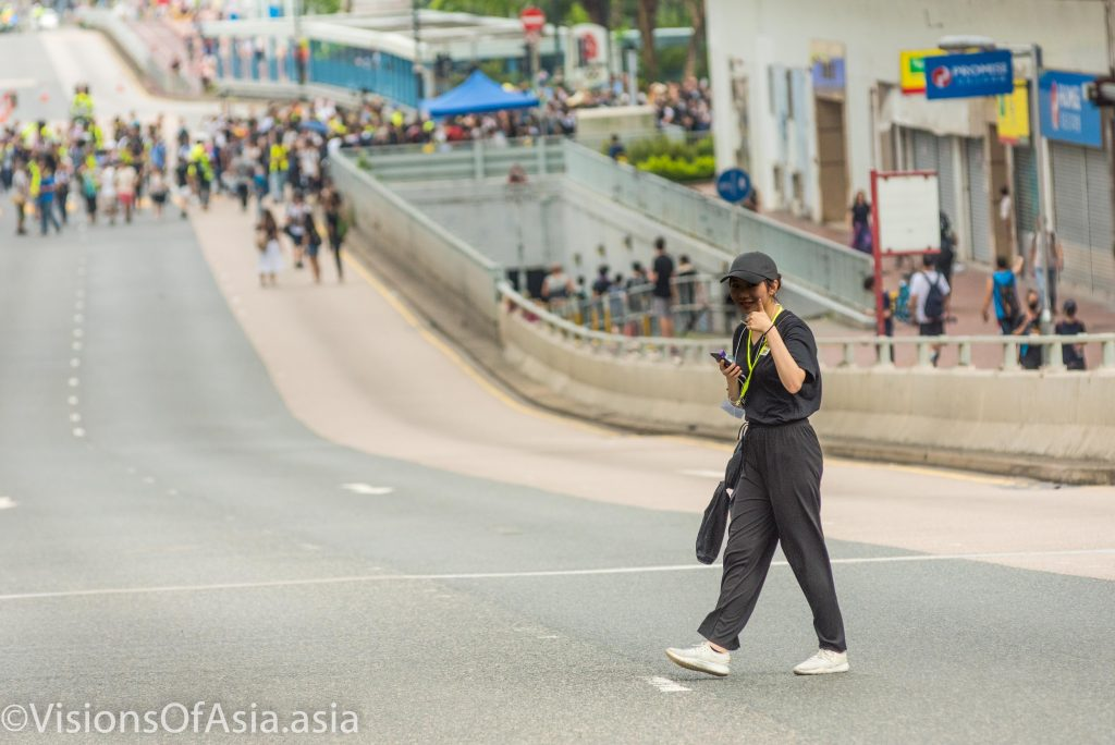 A protester gives a thumbs-up to the camera
