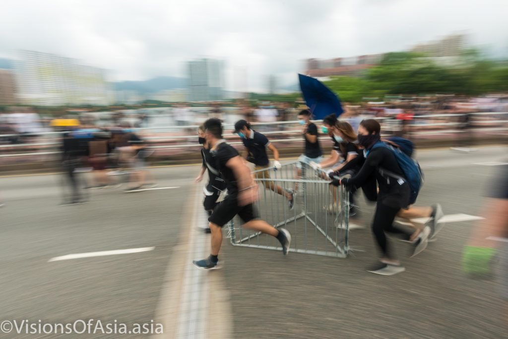 Protesters dragging barricades