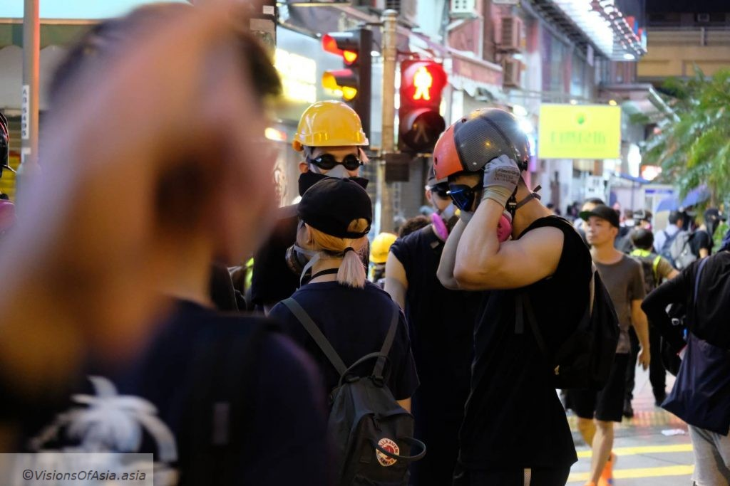 A protesters wears his helmet