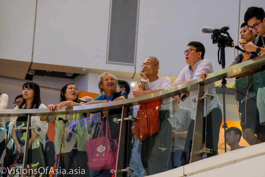 Older retirees watch as APM prepares to sing