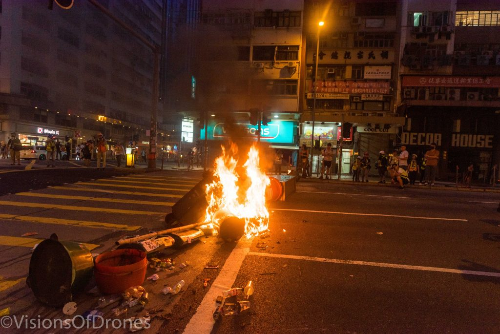 A garbage fire lit by protesters
