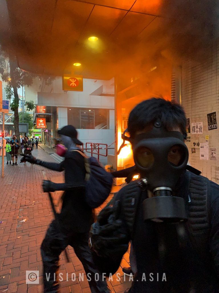 Protesters escape as a blaze consumes Wanchai station