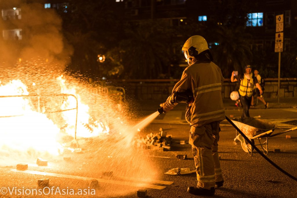 A fireman extinguishes the blaze in Wong Tai Sin