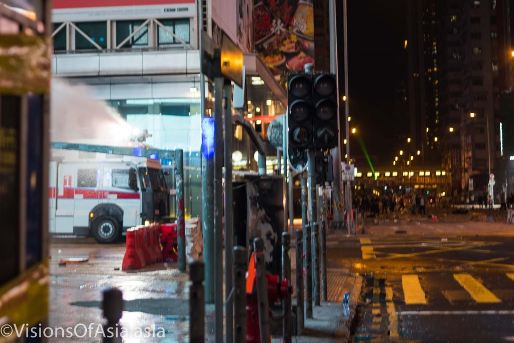 A water cannon shoots on a side road of Mongkok to disperse protesters.