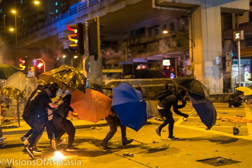 Protesters advance towards the police station