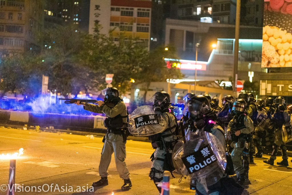 Riot police takes aim to the protesters while clearing Nathan Road