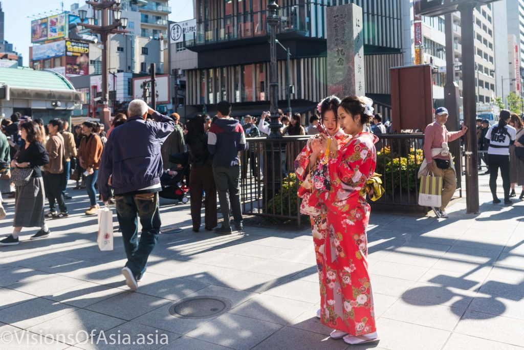Asian tourists dressed in kimono