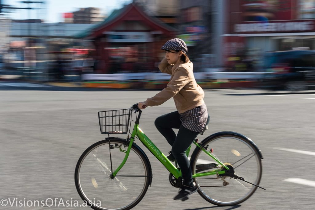 A lady on bicycle