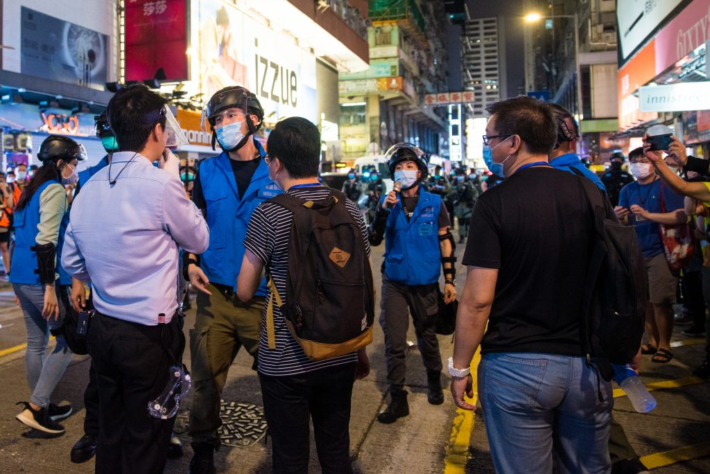Ted Hui facing off with the police