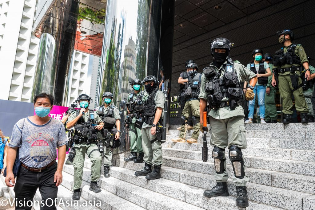 Riot police stand guard near the US consulate in Hong Kong on July 4th, 2020.