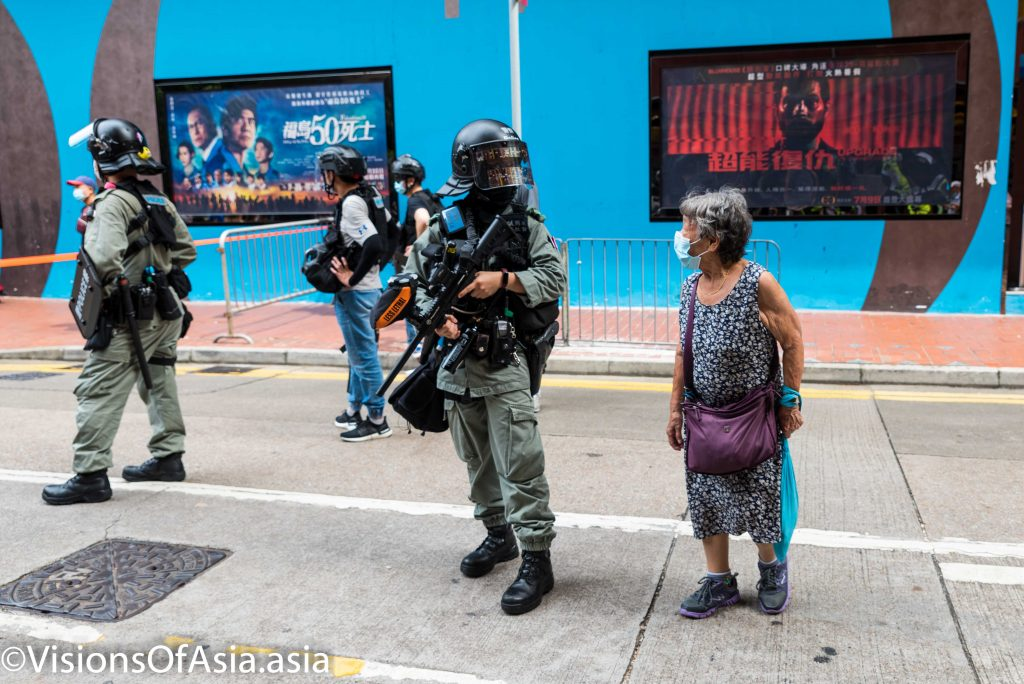 Staring contest between riot police and an old lady