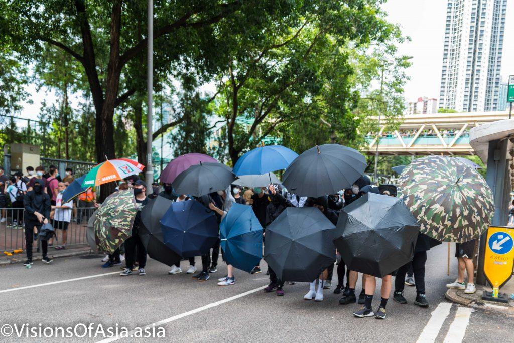 Frontliners form an umbrella wall