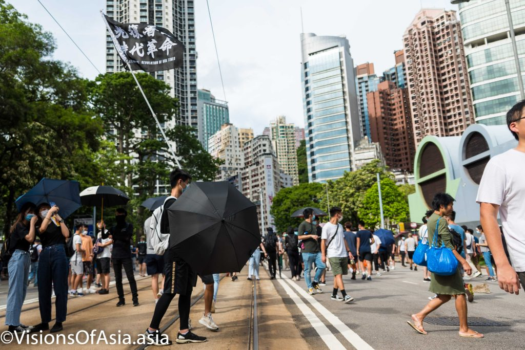 """Youngsters fly the """"liberate Hong Kong"""" flag"""