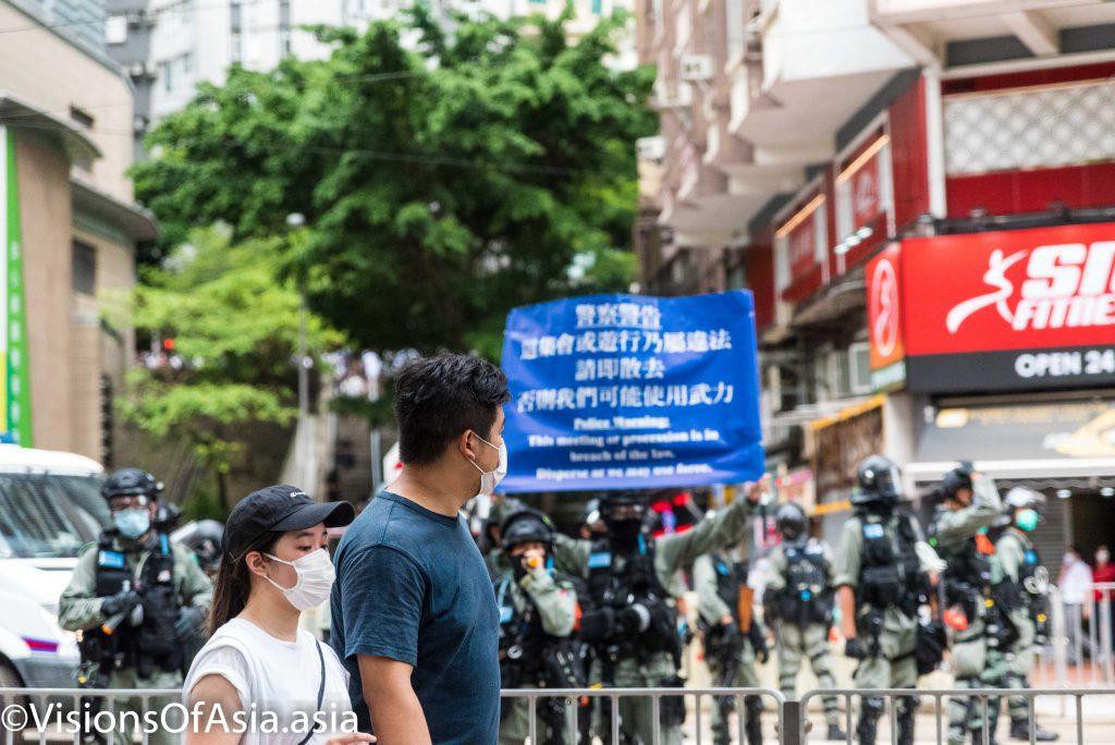 Police hoist blue flag in Tin Hau