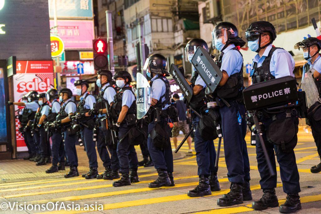 Riot police form a cordon in Sai Yeung Choi South street, in Mongkok