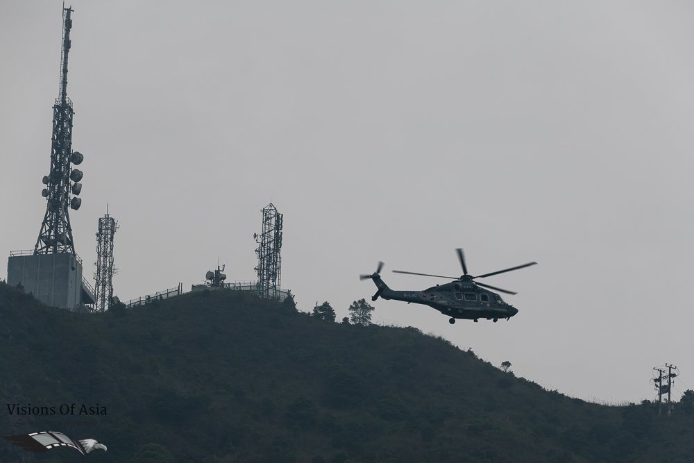 The GFS helicopter flying near the Radio tower of Kowloon Peak