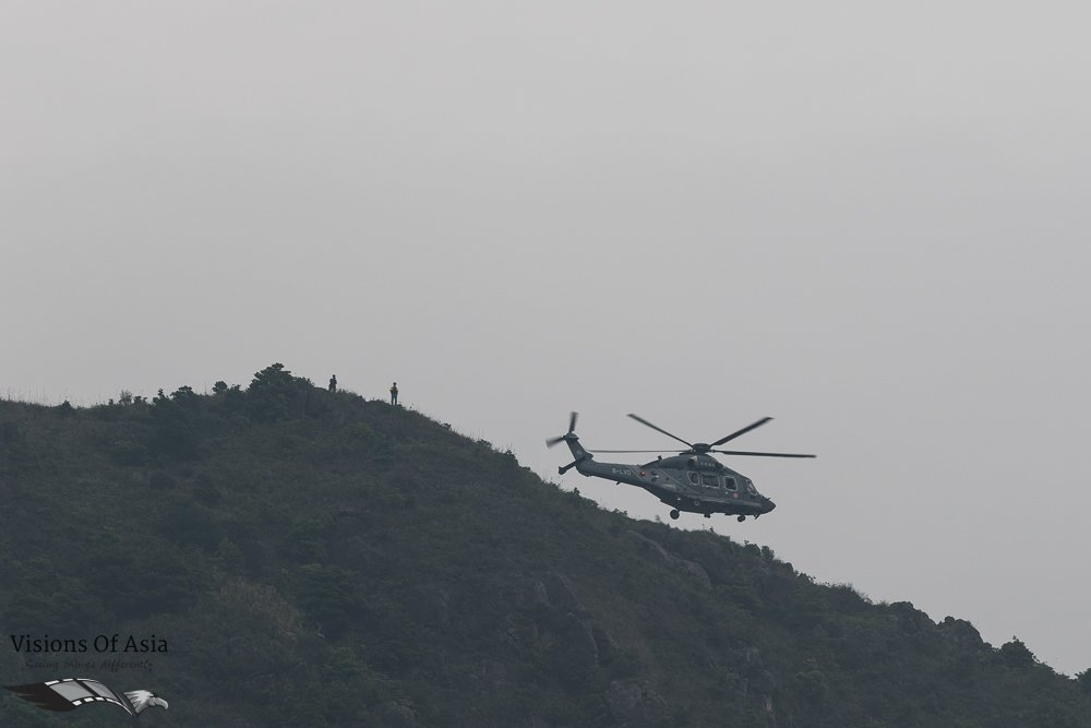 GFS helicopter flies around the mountain