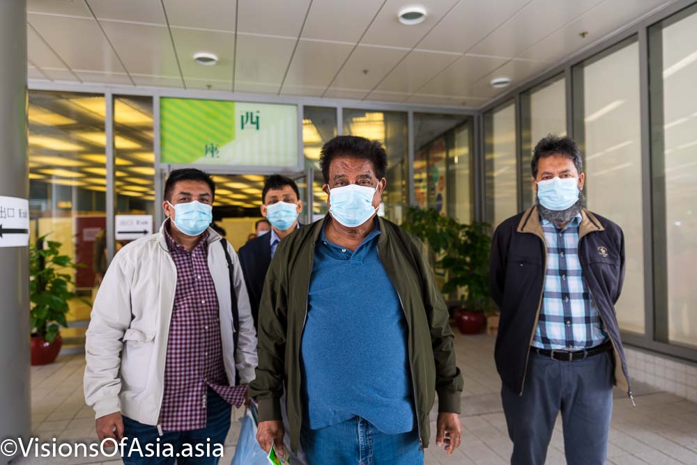 An elderly man and his family takes Pfizer vaccine in Hong Kong